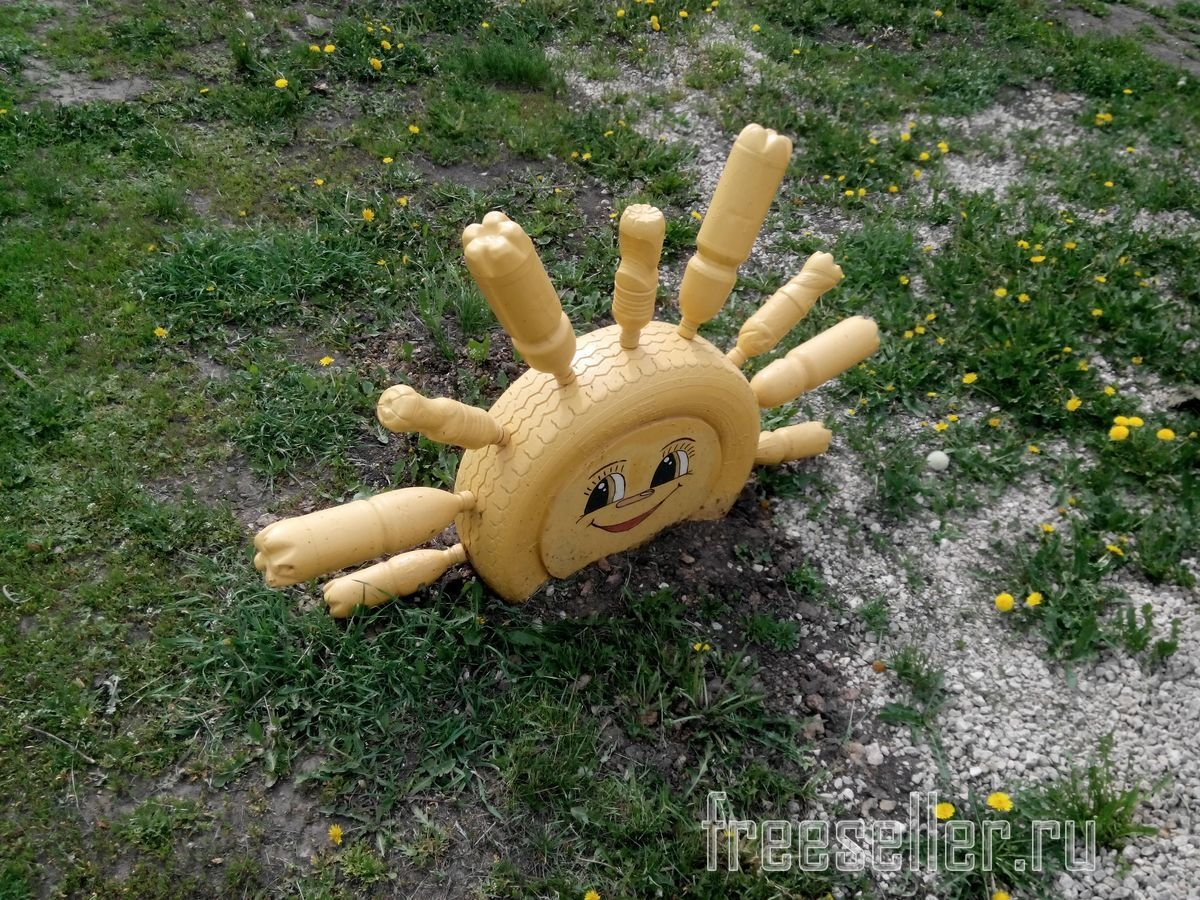 Солнышко из шин своими руками фото